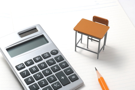 54035702 - notebook, calculator, pencil and miniature desk on white background.